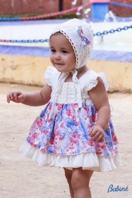 Vestido de bebé con estampado rojo y azulón